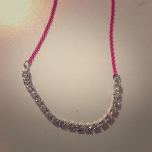 Children's diamond necklace with pink chain.